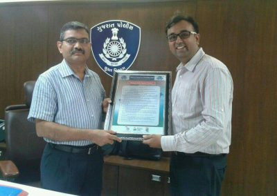 "Mr. Chintan Pathak presented Oath of ""Responsible Digital Citizen"" to Mr. Narsimha Komar Sir (Ex IG Surat Range Police) at IG Bhavan, Surat."