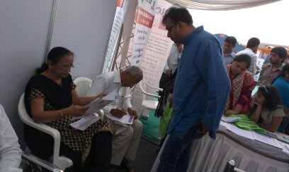 "Mr. Chintan Pathak explaining about the importance of ""Cyber Safety for Senior Citizen"" to Ex. Mayor Shri. Fakirbhai Chauhan Sir and Smt. Snehlataben Chauhan during ""Cyber Safety for All Campaign"" at National Book Fair-2014, Surat."