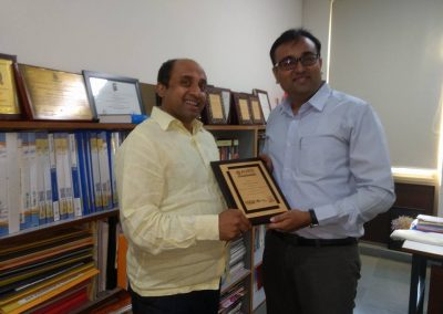 Mr. Chintan Pathak felicitated by Mr. Ramanujam (HOD of Law Faculty, Auro University) during National Moot Competition-2018 organized by Auro University.