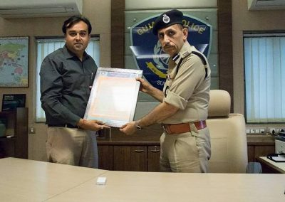 "Mr. Chintan Pathak presented Oath of ""Responsible Digital Citizen"" to Shri. Satish Sharma Sir, Commissioner of Police, Surat City after successfuly completed ""Cyber Safety for All Campaign - 2018"" with Surat City Police."