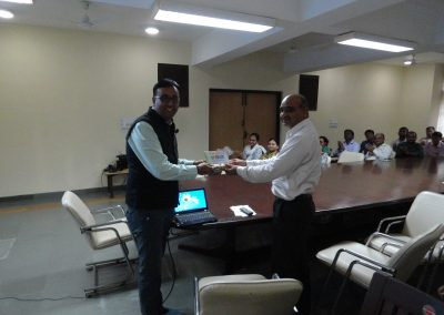 "Mr. Chintan Pathak felicitated by Mr. Amrish Patel, CEO of Bidas Farm during Training Session on ""Cyber Security for Corporate""."