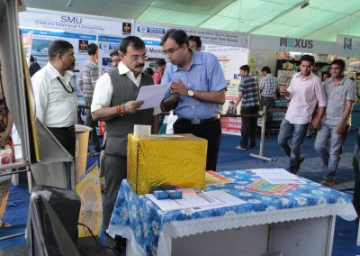 "Mr. Chintan Pathak is explaining about the ""Cyber Safety of Citizen"" to Mayor Shri. Rajendrabhai Desai during ""Cyber Safety for All Campaign"" at National Bookfair-2011."