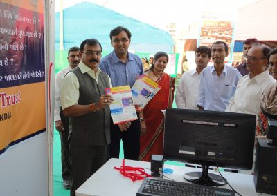 "Mayor Shri. Rajendrabhai Desai and Mrs. Rupal Shah, Chairman of  ""Nari Sanrakshan Gruh"" launched first ever news letter ""Times of Digital Wisdom"" during ""Cyber Safety for All Campaign"" at National Book Fair-2011 with Mr. Chintan Pathak, President of Vision of Tomorrow Charitable Trust."