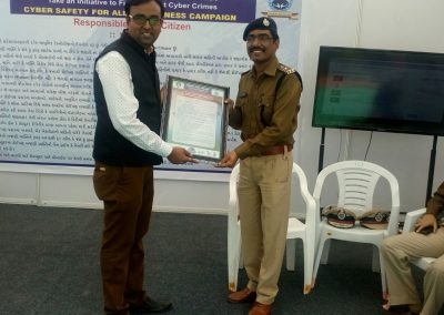 "Mr. Chintan Pathak presented Oath of ""Responsible Digital Citizen"" to Mr. Vishalkumar Waghela Sir (DCP Crime, Surat City Police) during ""Cyber Safety for All Campaign"" at National Book Fair-2016, Surat."