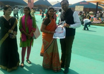"Mr. Chintan Pathak presented ""Calendar on Women Internet Safety Education – WISE"" to Mrs. Rupalben Shah (Chairman, Nari Sanrakshan Gruh & Cultural Committee of SMC) during ""Cyber Safety for All Campaign"" at National Book Fair-2016, Surat."