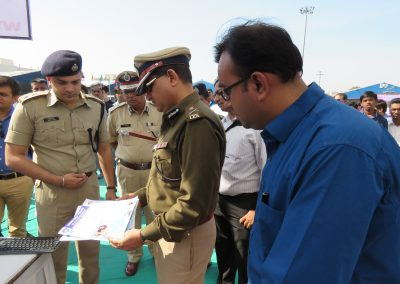"Mr. Chintan Pathak introducing news letter ""Times of  Digital Wisdom"" to Shri. Rakeshkumar Asthana Sir (Commissioner of Police, Surat) during ""Cyber Safety for All Campaign"" at National Book Fair-2015, Surat."