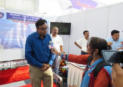 "Mr. Chintan Pathak disscussing importance of ""Cyber Safety Aweareness in Common Man"" with News Channel during ""Cyber Safety for All Campaign"" at National Book Fair-2016, Surat."