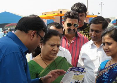 "Mr. Chintan Pathak explaining importance of  ""Women Internet Safety Education – WISE"" for Digital India to Smt. Darshanaben Jardosh (MP,Surat) during ""Cyber Safety for All Campaign"" at National Book Fair-2015, Surat."