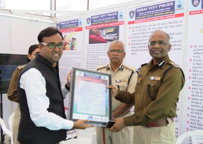 "Mr. Chintan Pathak presented Oath of ""Responsible Digital Citizen"" to Shri. V.M Parghi Sir (Joint Additional Commissioner of Police, Surat City) during ""Cyber Safety for All Campaign"" at National Book Fair-2016, Surat."