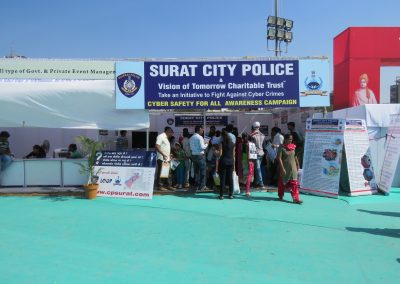 "Mr. Chinatan Pathak, President of Vision of Tomorrow Charitable Trust (NGO) and his team explaining about the Cyber Safety to the visitors during ""Cyber Safety for All Campaign"" with Surat City Police at National Book Fair-2016, Surat."