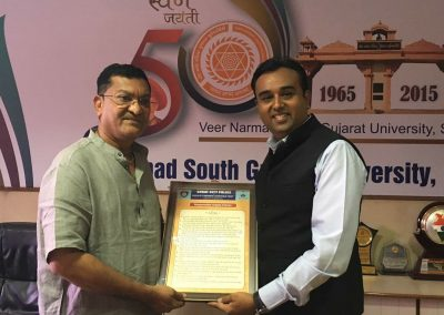 "Mr. Chintan Pathak presented Oath of ""Responsible Digital Citizen"" to Dr. Daxesh Thakkar (Ex Vice Chancellor of Veer Narmad South Gujarat University, Surat) at VNSGU Campus."