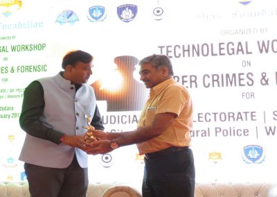 "Mr. Chintan Pathak felicitated by Mr. Doshi Sir, District & Session Judge of Vadodara City during during Technolegal Workshop on ""Cyber Crimes & Forensic"" for Judiciary, Collectorate, Sr. Police Executives, City Police, Range Police and Western Railway Police at MS University Campus, Vadodara."